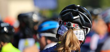blonde female Cyclist safety helmet during the start of the cycling race