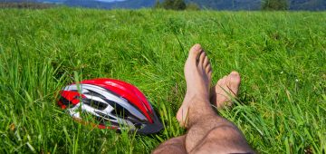 Cyclist relax. Man feet closeup of cyclist relaxing on hill enjoying sun on sunny summer day in a mountains. Poland, Bieszczady.