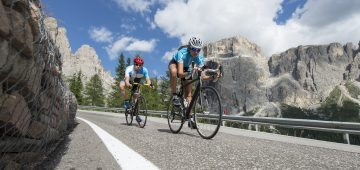 Downhill cycling road race in the italian dolomites